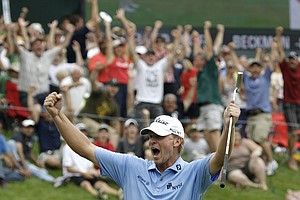 Steve Stricker reacts after making a birdie putt on the eighteenth green to win the John Deere Classic golf tournament at TPC Deere Run Sunday, July 10, 2011, in Silvis, Ill.
