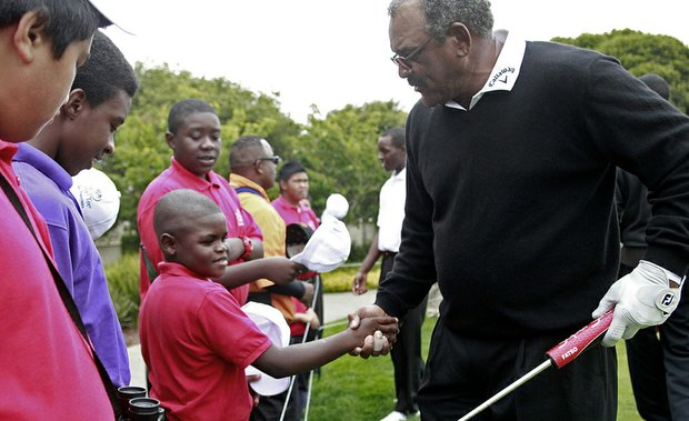 Rafiq Griffin, center, of First Tee San Francisco, shakes hands with Jim Thorpe during the Champions Tour's Nature Valley First Tee Open.