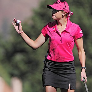 Paula Creamer waves after putting out on the second hole during the conclusion of the first round, which was delayed by weather, of the Women's U.S. Open golf tournament at the Broadmoor Golf Club on Friday, July 8, 2011, in Colorado Springs, Colo.
