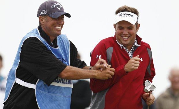 Phil Mickelson's caddie, Jim Mackay, and Jeff Overton share a laugh during Tuesday's practice round at Royal St. George's.