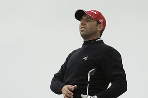 Spain's Sergio Garcia watches his shot on the 4th fairway during the first day of the British Open Golf Championship at Royal St George's golf course Sandwich, England, Thursday, July 14, 2011.