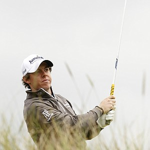 Northern Ireland's Rory McIlroy hits a shot from the 8th tee during the first day of the British Open Golf Championship at Royal St George's golf course Sandwich, England, Thursday, July 14, 2011.