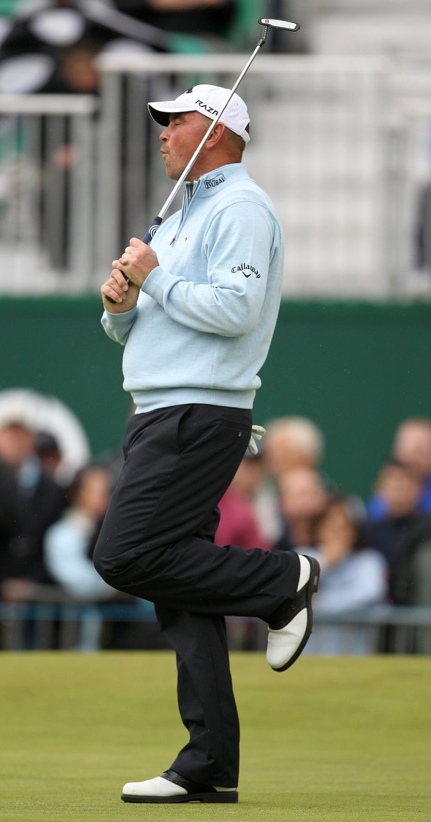 Denmark's Thomas Bjorn reacts after missing a putt on the 18th green during the first day of the British Open Golf Championship at Royal St George's golf course Sandwich, England, Thursday, July 14, 2011.