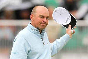 Denmark's Thomas Bjorn acknowledges the crowd after finishing his round on the first day of the British Open Golf Championship at Royal St George's golf course Sandwich, England, Thursday, July 14, 2011.