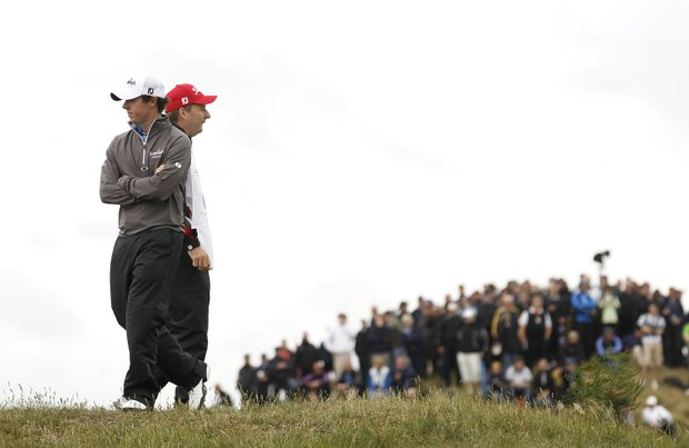 Northern Ireland's Rory McIlroy and his caddie JP Fitzgerald, right, stand on the 8th fairway during the first day of the British Open Golf Championship at Royal St George's golf course Sandwich, England, Thursday, July 14, 2011.