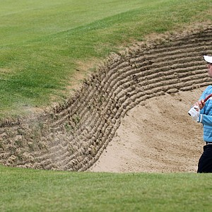 Nick Watney of the US hits a ball out of the bunker onto the 6th green during the first day of the British Open Golf Championship at Royal St George's golf course Sandwich, England, Thursday, July 14, 2011.