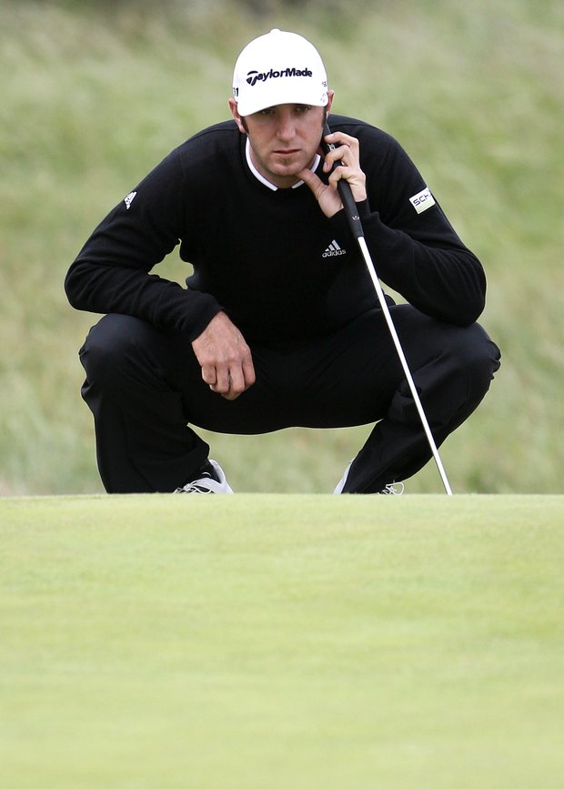 Dustin Johnson of the US lines up a putt on the 3rd green during the first day of the British Open Golf Championship at Royal St George's golf course Sandwich, England, Thursday, July 14, 2011.