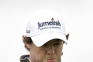 Northern Ireland's Rory McIlroy reacts after his shot from the 4th tee during the first day of the British Open Golf Championship at Royal St George's golf course Sandwich, England, Thursday, July 14, 2011.