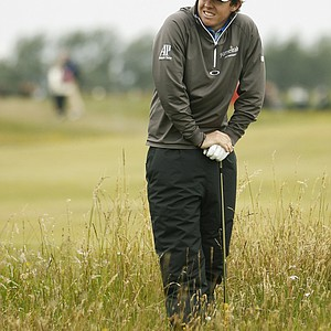 Northern Ireland's Rory McIlroy stands in the rough on the 15th hole during the first day of the British Open Golf Championship at Royal St George's golf course Sandwich, England, Thursday, July 14, 2011.