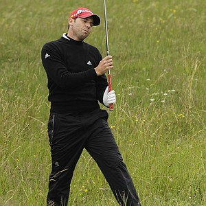 Spain's Sergio Garcia reacts after playing a shot from the rough on the 15th hole during the first day of the British Open Golf Championship at Royal St George's golf course Sandwich, England, Thursday, July 14, 2011.