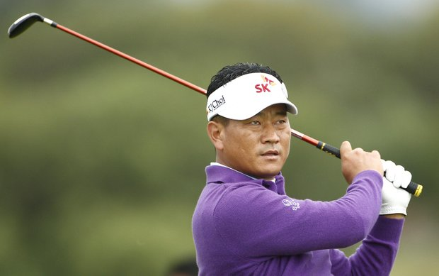 Korea's KJ Choi plays a shot on the 4th fairway during the first day of the British Open Golf Championship at Royal St George's golf course Sandwich, England, Thursday, July 14, 2011.