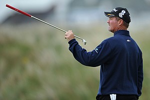 Jerry Kelly gestures to a TV cameraman during the first round of the Open Championship