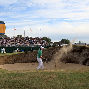 Northern Ireland's Rory McIlroy hits out of the bunker on the 18th hole during the second day of the British Open Golf Championship at Royal St George's golf course Sandwich, England, Friday, July 15, 2011.