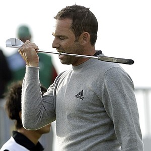 Spain's Sergio Garcia bites his putter after putting on the 18th green during the second day of the British Open Golf Championship at Royal St George's golf course Sandwich, England, Friday, July 15, 2011.