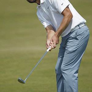 Lucas Glover of the U.S. putts on the 17th green during the second day of the British Open Golf Championship at Royal St George's golf course Sandwich, England, Friday, July 15, 2011.