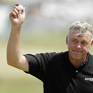 Northern Ireland's Darren Clarke reacts after putting on the 18th green during the second day of the British Open Golf Championship at Royal St George's golf course Sandwich, England, Friday, July 15, 2011.