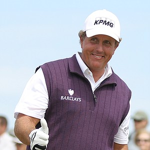 Phil Mickelson of the US gestures after his shot off the 8th tee during the second day of the British Open Golf Championship at Royal St George's golf course Sandwich, England, Friday, July 15, 2011.
