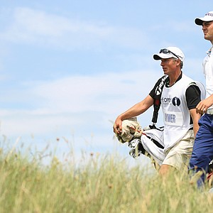 Germany's Martin Kaymer and his caddie Christian Donald walks down the 18th fairway during the second day of the British Open Golf Championship at Royal St George's golf course Sandwich, England, Friday, July 15, 2011.