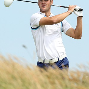 Germany's Martin Kaymer hits a shot from the 18th tee during the second day of the British Open Golf Championship at Royal St George's golf course Sandwich, England, Friday, July 15, 2011.