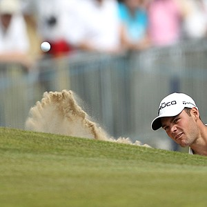 Germany's Martin Kaymer hits a shot out of a bunker onto the 18th green during the second day of the British Open Golf Championship at Royal St George's golf course Sandwich, England, Friday, July 15, 2011.