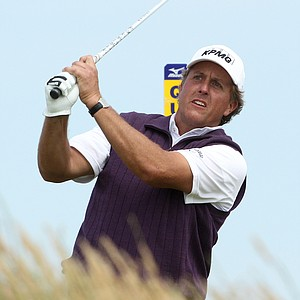 Phil Mickelson of the US hits a shot off the 18th tee during the second day of the British Open Golf Championship at Royal St George's golf course Sandwich, England, Friday, July 15, 2011.
