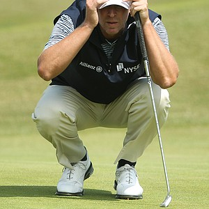 Steve Stricker of the US lines up a putt on the 16th green during the second day of the British Open Golf Championship at Royal St George's golf course Sandwich, England, Friday, July 15, 2011.