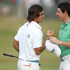 Northern Ireland's Rory McIlroy, right, and Rickie Fowler of the U.S. shake hands at the end of their round on the 18th green during the second day of the British Open Golf Championship at Royal St George's golf course Sandwich, England, Friday, July 15, 2011.