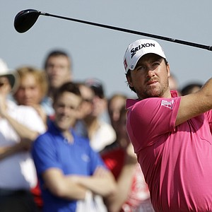 Northern Ireland's Graeme McDowell hits a shot on the 4th tee during the second day of the British Open Golf Championship at Royal St George's golf course Sandwich, England, Friday, July 15, 2011.
