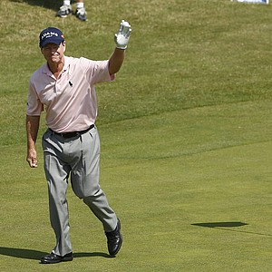 Tom Watson of the US acknowledges the crowd on the 6th green after his hole in one during the second day of the British Open Golf Championship at Royal St George's golf course Sandwich, England, Friday, July 15, 2011.