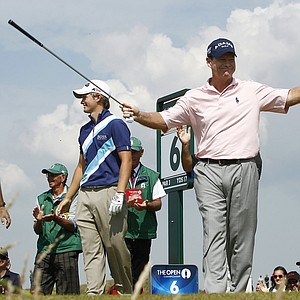 Tom Watson of the US reacts at the 6th tee after his hole in one during the second day of the British Open Golf Championship at Royal St George's golf course Sandwich, England, Friday, July 15, 2011.