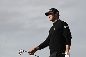 Dustin Johnson of the US walks down the 18th fairway during the third day of the British Open Golf Championship at Royal St George's golf course Sandwich, England, Saturday, July 16, 2011.