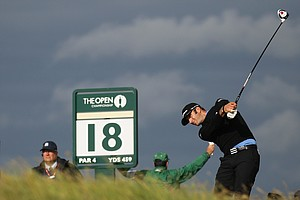 Dustin Johnson of the US plays a shot off the 18th tee during the third day of the British Open Golf Championship at Royal St George's golf course Sandwich, England, Saturday, July 16, 2011.