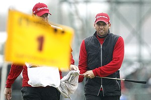 Spain's Sergio Garcia cleans his putter with his caddie Glen Murray on the 1st green during the third day of the British Open Golf Championship at Royal St George's golf course Sandwich, England, Saturday, July 16, 2011.
