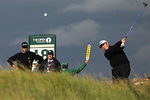 South Africa's George Coetzee plays a shot off the 18th tee as Dustin Johnson of the US, left, looks on during the third day of the British Open Golf Championship at Royal St George's golf course Sandwich, England, Saturday, July 16, 2011.