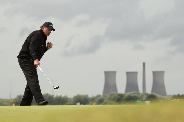 Phil Mickelson of the United States celebrates holing a birdie putt on the 10th green during the final round of The 140th Open Championship at Royal St George's on July 17, 2011 in Sandwich, England.