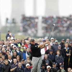 Northern Ireland's Darren Clarke plays a shot off the 3rd tee during the final day of the British Open Golf Championship at Royal St George's golf course Sandwich, England, Sunday, July 17, 2011.