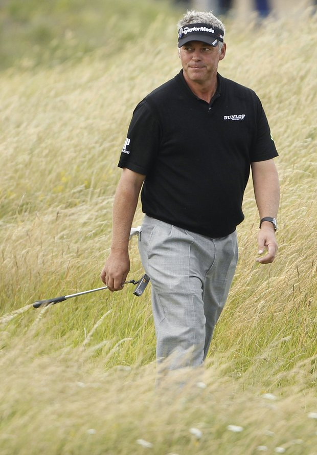 Northern Ireland's Darren Clarke walks down the 4th fairway during the final day of the British Open Golf Championship at Royal St George's golf course Sandwich, England, Sunday, July 17, 2011.