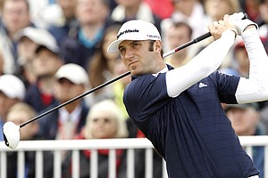 Dustin Johnson of the US hits a shot off the 1st tee during the final day of the British Open Golf Championship at Royal St George's golf course Sandwich, England, Sunday, July 17, 2011.