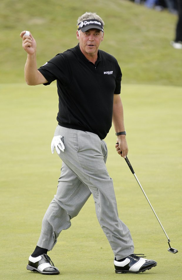 Northern Ireland's Darren Clarke reacts after putting on the 2nd hole during the final day of the British Open Golf Championship at Royal St George's golf course Sandwich, England, Sunday, July 17, 2011.