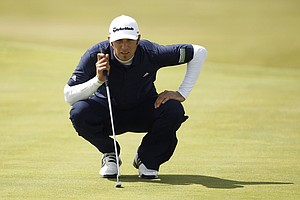 Dustin Johnson of the US lines up a putt on the 3rd green during the final day of the British Open Golf Championship at Royal St George's golf course Sandwich, England, Sunday, July 17, 2011.