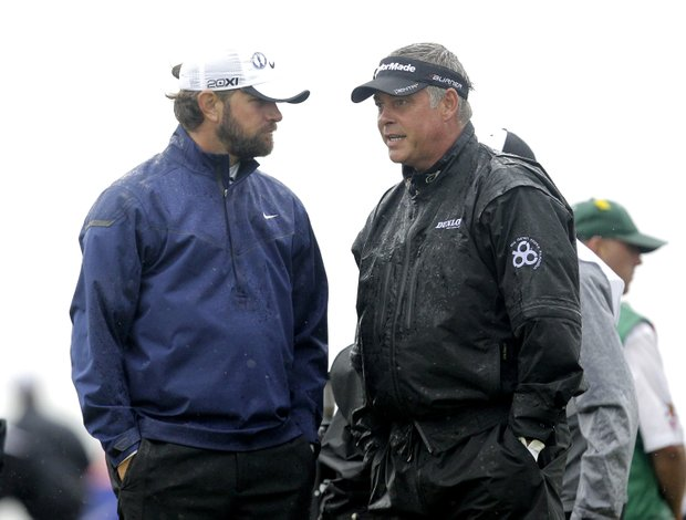 Northern Ireland's Darren Clarke, right, and Lucas Glover of the U.S. talk before they tee off from the 3rd during the third day of the British Open Golf Championship at Royal St George's golf course Sandwich, England, Saturday, July 16, 2011.