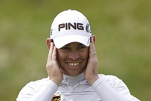 South Africa's Louis Oosthuizen reacts on the 4th green during the final day of the British Open Golf Championship at Royal St George's golf course Sandwich, England, Sunday, July 17, 2011.
