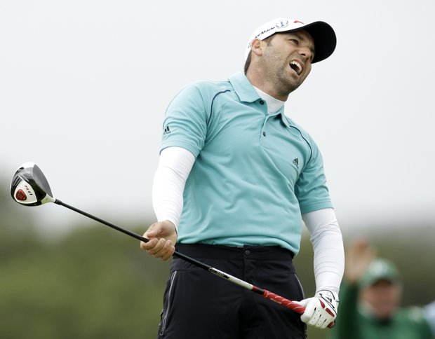 Spain's Sergio Garcia reacts after playing a shot off the 5th tee during the final day of the British Open Golf Championship at Royal St George's golf course Sandwich, England, Sunday, July 17, 2011.