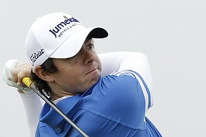 Northern Ireland's Rory McIlroy hits a shot off the 5th tee during the final day of the British Open Golf Championship at Royal St George's golf course Sandwich, England, Sunday, July 17, 2011.