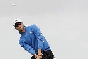 Australia's Adam Scott plays a shot on the 3rd fairway during the final day of the British Open Golf Championship at Royal St George's golf course Sandwich, England, Sunday, July 17, 2011.