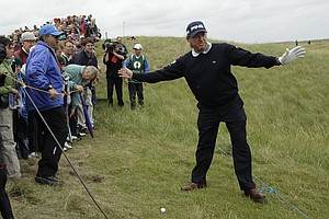 Spain's Miguel Angel Jimenez gestures to the crowd on the 6th fairway during the final day of the British Open Golf Championship at Royal St George's golf course Sandwich, England, Sunday, July 17, 2011.