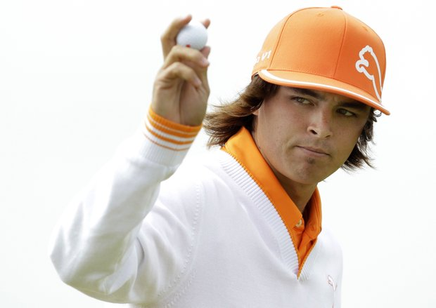 Rickie Fowler of the U.S. reacts after putting on the 3rd green during the final day of the British Open Golf Championship at Royal St George's golf course Sandwich, England, Sunday, July 17, 2011.