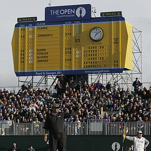 Northern Ireland's Darren Clarke reacts in front of the scoreboard on the 18th green after his round during the third day of the British Open Golf Championship at Royal St George's golf course Sandwich, England, Saturday, July 16, 2011.
