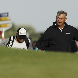 Northern Ireland's Darren Clarke walks up to the 18th green during the third day of the British Open Golf Championship at Royal St George's golf course Sandwich, England, Saturday, July 16, 2011.