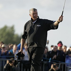 Northern Ireland's Darren Clarke reacts after putting on the 18th green during the third day of the British Open Golf Championship at Royal St George's golf course Sandwich, England, Saturday, July 16, 2011.
